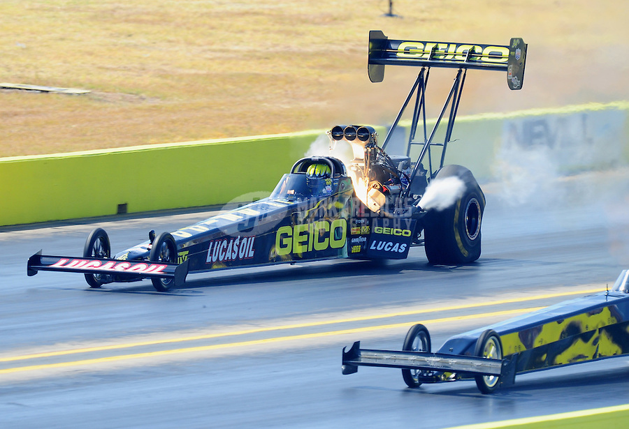 Sept. 24, 2011; Ennis, TX, USA: NHRA top fuel dragster driver Morgan Lucas blows a head gasket during qualifying for the Fall Nationals at the Texas Motorplex. Mandatory Credit: Mark J. Rebilas-