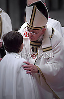Pope Francis,Baptism during the Easter vigil mass in Saint Peter's Basilica, in the Vatican..April 18,2014