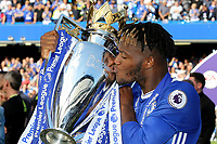 Michy Batshuayi of Chelsea kisses the Premier League Trophy during Chelsea vs Sunderland AFC, Premier League Football at Stamford Bridge on 21st May 2017