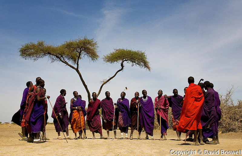 A gathering of Maasai men outside their village in Ngorongoro Conservation Area, Northern Tanzania.