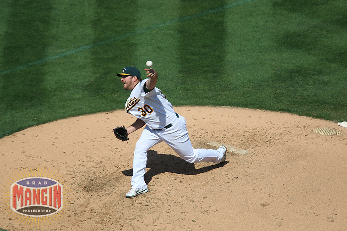 OAKLAND, CA - SEPTEMBER 14:  Dana Eveland of the Oakland Athletics pitches during the game against the Texas Rangers at the McAfee Coliseum in Oakland, California on September 14, 2008.  The Athletics defeated the Rangers 7-4.  Photo by Brad Mangin
