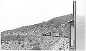 K-28 #471 climbing Barranca Hill with mixed Chili Line train.<br /> D&amp;RGW  Barranca Hill, NM  Taken by Maxwell, John W. - 2/23/1940