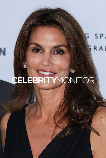 CENTURY CITY, CA - JUNE 27: Cindy Crawford attends the Helmut Newton opening night exhibit at Annenberg Space For Photography on June 27, 2013 in Century City, California. (Photo by Celebrity Monitor)
