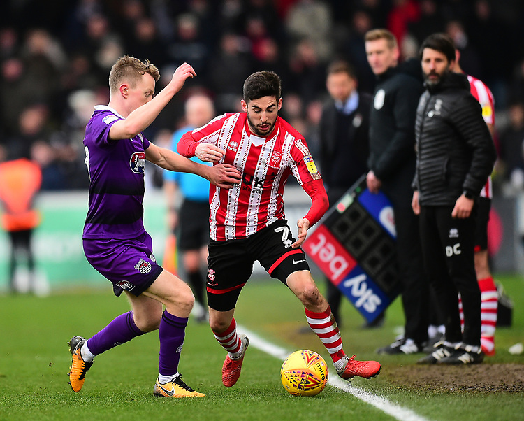 Lincoln City's Tom Pett battles with Grimsby Town's Luke Hendrie<br /> <br /> Photographer Andrew Vaughan/CameraSport<br /> <br /> The EFL Sky Bet League Two - Lincoln City v Grimsby Town - Saturday 19 January 2019 - Sincil Bank - Lincoln<br /> <br /> World Copyright © 2019 CameraSport. All rights reserved. 43 Linden Ave. Countesthorpe. Leicester. England. LE8 5PG - Tel: +44 (0) 116 277 4147 - admin@camerasport.com - www.camerasport.com