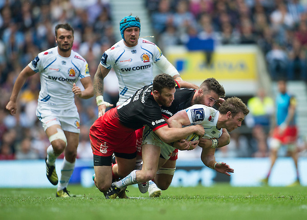 Will Chudley of Exeter Chiefs is tackled by Duncan Taylor of Saracens and Will Fraser<br /> <br /> Photographer Ashley Western/CameraSport<br /> <br /> Rugby Union - Aviva Premiership Final - Saracens v Exeter Chiefs - Saturday 28th May 2016 - Twickenham Stadium, Twickenham, London  <br /> <br /> World Copyright &copy; 2016 CameraSport. All rights reserved. 43 Linden Ave. Countesthorpe. Leicester. England. LE8 5PG - Tel: +44 (0) 116 277 4147 - admin@camerasport.com - www.camerasport.com
