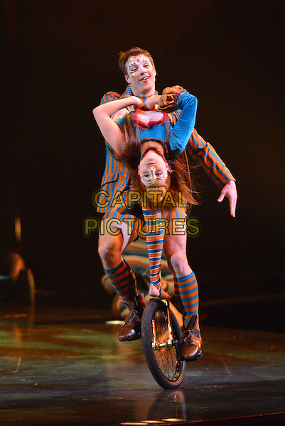 LONDON, UNITED KINGDOM - JANUARY 04: Philippe Belanger and Marie-Lee Guilbert perform the unicycle duo act during the dress rehearsal for 'Kooza' by Cirque Du Soleil' at Royal Albert Hall on January 4, 2015 in London, England.<br /> CAP/PL<br /> &copy;Phil Loftus/Capital Pictures