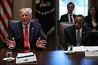 United States President Donald J. Trump speaks during a Cabinet Meeting in the Cabinet Room of the White House on November 19, 2019 in Washington, DC.  At right is US Secretary of Housing and Urban Development (HUD) Ben Carson.<br /> Credit: Oliver Contreras / Pool via CNP/AdMedia