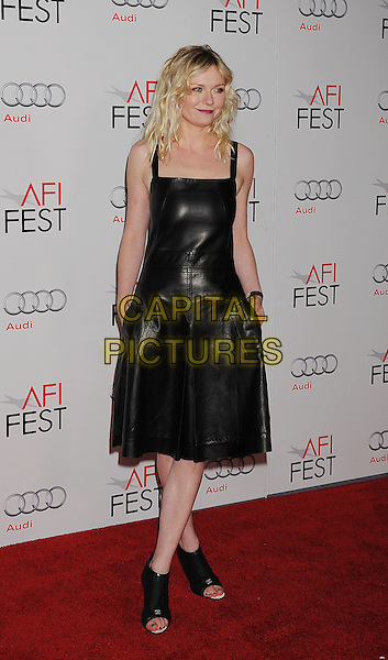 Kirsten Dunst.AFI Fest 2011 - Los Angeles Time Young Hollywood Panel held at Grauman's Chinese Theatre, Hollywood, California, USA..November 4th, 2011.full length leather dress sleeveless heels open toe cage chanel ankle hands in pockets black.CAP/ROT/TM.©Tony Michaels/Roth Stock/Capital Pictures
