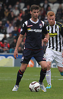 Stuart Kettlewell being closed down by Conor Newton in the St Mirren v Ross County Scottish Professional Football League Premiership match played at St Mirren Park, Paisley on 3.5.14.