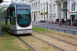 Tram tracks running over grass surface through city streets Rotterdam, Netherlands