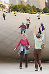 Two mature females clown in reflection of Chicago Cloud sculpture in Millineum Park, Chicago , Illinois