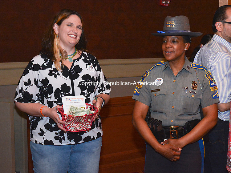 WATERBURY, CT-042917JS09- Campership secretary Allison Dederer Romano, left, and Connecticut State Trooper First Class Kelly Grant  were among those to help collect donation for the Greater Waterbury Campership Fund during intermission at the Palace Theatre in Waterbury. <br /> Jim Shannon Republican-American