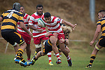 Karaka winger Harry Luteru is tackled by Josh Allen as he heads infield on a run. Counties Manukau Premier Club Rugby game between Bombay and Karaka, played at Bombay, on Saturday March 15 2014. Karaka won the game 39 - 12 after leading 13 - 5 at halftime.  Photo by Richard Spranger