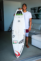 Snapper Rocks, Coolangatta, Queensland Australia. (Sunday March 16, 2014) –  Winner of the Quiksilver Pro Gold Coast Gabriel Medina (BRA)  with the surfboard he rode to victory at his rental accommodation in Coolangatta. Photo: joliphotos.com