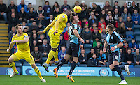Garry Thompson of Wycombe Wanderers & Chey Dunkley of Oxford United during the Sky Bet League 2 match between Wycombe Wanderers and Oxford United at Adams Park, High Wycombe, England on 19 December 2015. Photo by Andy Rowland.