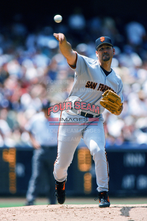 Mark Gardner of the San Francisco Giants pitches during a 1999 Major League Baseball season game against the Los Angeles Dodgers at Dodger Stadium in Los Angeles, California. (Larry Goren/Four Seam Images)