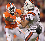 03 Dec 2011: Clemson Tigers safety Jonathan Meeks (5) brings pressure to Virginia Tech Hokies quarterback Logan Thomas (3) at Bank of America Stadium, Charlotte, North Carolina. Clemson and Virginia Tech are tied 10-10 at the half.