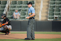Home plate umpire Sam Burch between innings of the South Atlantic League game between the Delmarva Shorebirds and the Kannapolis Intimidators at Kannapolis Intimidators Stadium on July 2, 2017 in Kannapolis, North Carolina.  The Shorebirds defeated the Intimidators 5-4.  (Brian Westerholt/Four Seam Images)