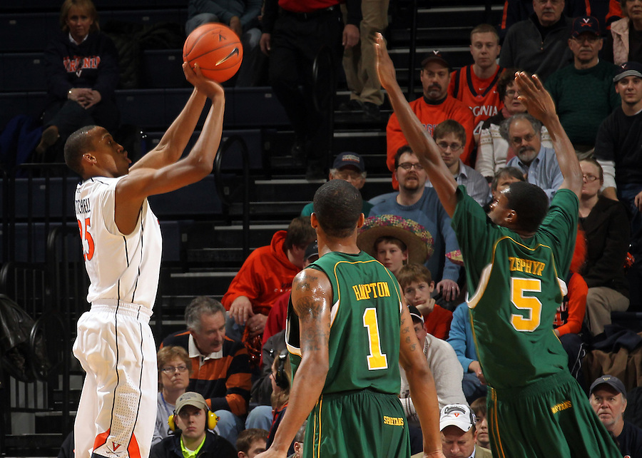 Dec. 20, 2010; Charlottesville, VA, USA; Virginia Cavaliers forward Akil Mitchell (25) shoots over Norfolk State Spartans guard/forward Rob Hampton (1) and Norfolk State Spartans forward Tim Zephyr (5) during the game at the John Paul Jones Arena. Mandatory Credit: Andrew Shurtleff