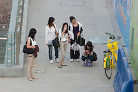 Daytime Landscape View Of A Group Of Five Women Standing And Laughing in Guangzhou, China.  © LAN