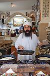 """Day 2 - """"The Yemenite"""" prepares lunch in Tzfat. (Photo by Brian Garfinkel)"""
