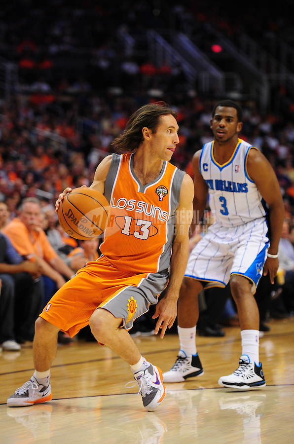 Mar. 25, 2011; Phoenix, AZ, USA; Phoenix Suns guard (13) Steve Nash against New Orleans Hornets guard (3) Chris Paul at the US Airways Center. The Hornets defeated the Suns 106-100. Mandatory Credit: Mark J. Rebilas-.