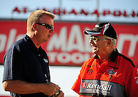 Sept. 6, 2010; Clermont, IN, USA; NHRA pro stock driver V. Gaines (right) talks with track official Kurt Johnson during the U.S. Nationals at O'Reilly Raceway Park at Indianapolis. Mandatory Credit: Mark J. Rebilas-