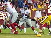 New York Giants running back Orleans Darkwa (26) carries the ball in the first quarter against the Washington Redskins at FedEx Field in Landover, Maryland on Thursday, November 23, 2017.<br /> Credit: Ron Sachs / CNP<br /> (RESTRICTION: NO New York or New Jersey Newspapers or newspapers within a 75 mile radius of New York City)