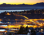 Seattle, Washington<br /> Evening view of the Olympic mountain skyline with hillside homes of the Magnolia neighborhood