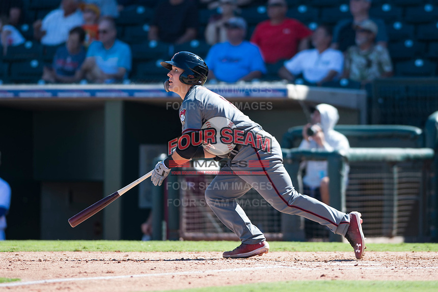 Salt River Rafters catcher Daulton Varsho (8), of the Arizona Diamondbacks organization, starts down the first base line during an Arizona Fall League game against the Surprise Saguaros on October 9, 2018 at Surprise Stadium in Surprise, Arizona. The Rafters defeated the Saguaros 10-8. (Zachary Lucy/Four Seam Images)