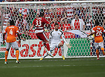 FC Dallas forward Kenny Cooper (33) shoots and scores a goal during the game between the FC Dallas and the Houston Dynamo at the FC Dallas Stadium in Frisco,Texas.