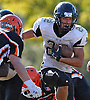 West Hempstead running back No. 22 Tommy Cannisi rushes for a gain during the third quarter of a Nassau County Conference IV varsity football game against host East Rockaway High School on Saturday, October 10, 2015. West Hempstead won by a score of 28-14.<br /> <br /> James Escher