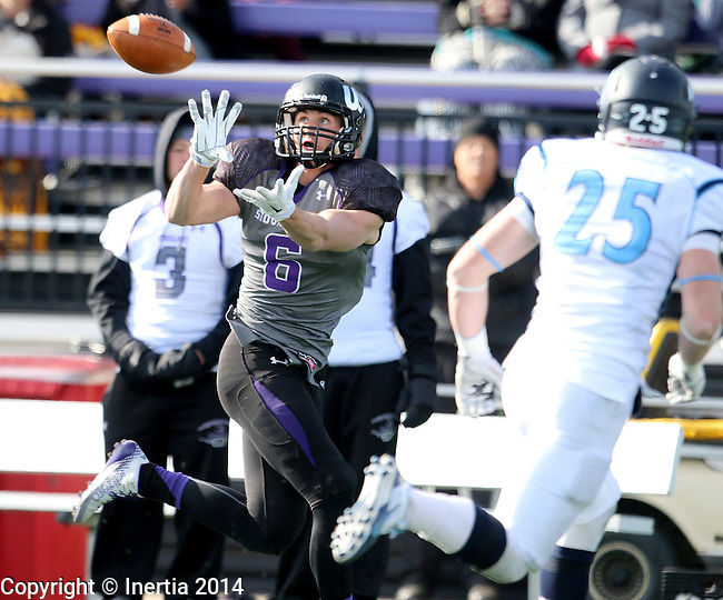 SIOUX FALLS, SD - NOVEMBER 8: Erik Albeck #6 from the University of Sioux Falls hauls in a pass in front of Alex VanGerpen #25 from Upper Iowa in the second quarter of their game Saturday afternoon at Bob Young Field in Sioux Falls.  (Photo by Dave Eggen/Inertia)