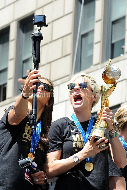 WWW.ACEPIXS.COM<br /> July 10, 2015 New York City <br /> <br /> Carli Lloyd and Megan Rapinoe aboard a float in the New York City Ticker Tape Parade for World Cup Champions U.S.A. Women's Soccer National Team on July 10, 2015 in New York City.<br /> <br /> <br /> Credit: Kristin Callahan/ACE Pictures<br /> <br /> Tel: 646 769 0430<br /> e-mail: info@acepixs.com<br /> web: http://www.acepixs.com