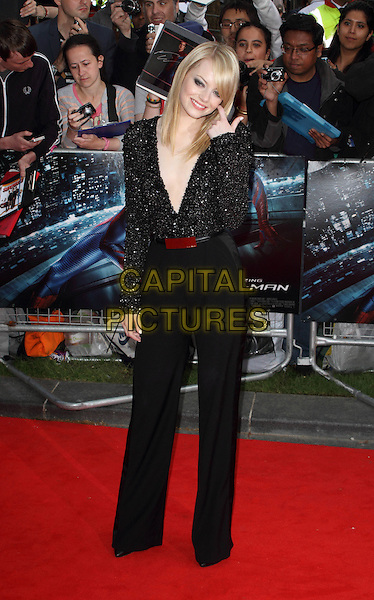 Emma Stone.UK Premiere of 'The Amazing Spider-Man' at the Odeon, Leicester Square, London, England..June 18th 2012.full length black sparkly beads beaded plunging neckline top red belt trousers shoulder pads  hand arm.CAP/ROS.©Steve Ross/Capital Pictures.