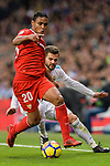 Luis Muriel of Sevilla FC (L) fights for the ball with Nacho Fernandez of Real Madrid (R) during La Liga 2017-18 match between Real Madrid and Sevilla FC at Santiago Bernabeu Stadium on 09 December 2017 in Madrid, Spain. Photo by Diego Souto / Power Sport Images