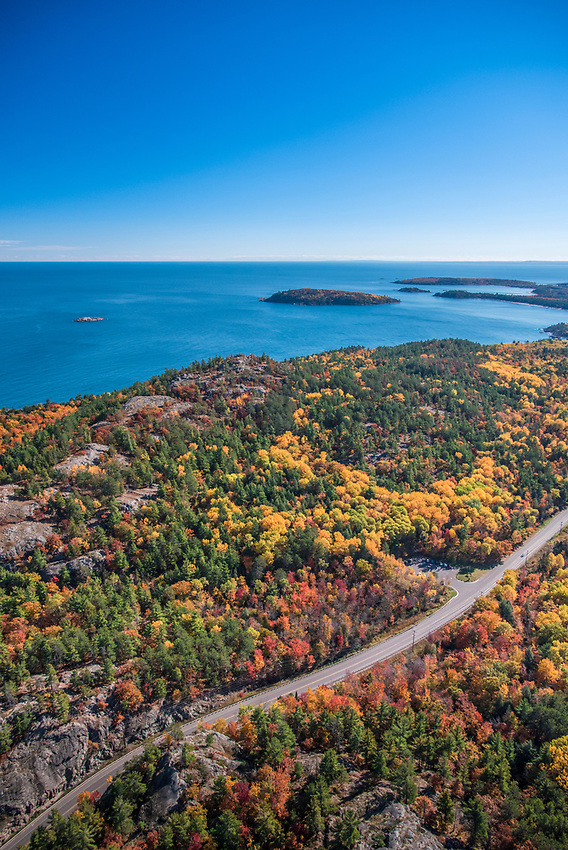 Aerial photography of  the rugged Lake Superior shoreline north of Marquette, Michigan during fall color season. Areas shown include County Road 550, Sugarloaf Mountain lookout, Partridge Island and Presque Isle Park.