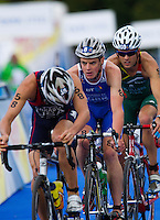 07 AUG 2011 - LONDON, GBR - Jonathan Brownlee (GBR) (centre) follows Matt Chrabot (USA) through transition for the start of another bike lap during the men's round of triathlon's ITU World Championship Series (PHOTO (C) NIGEL FARROW)