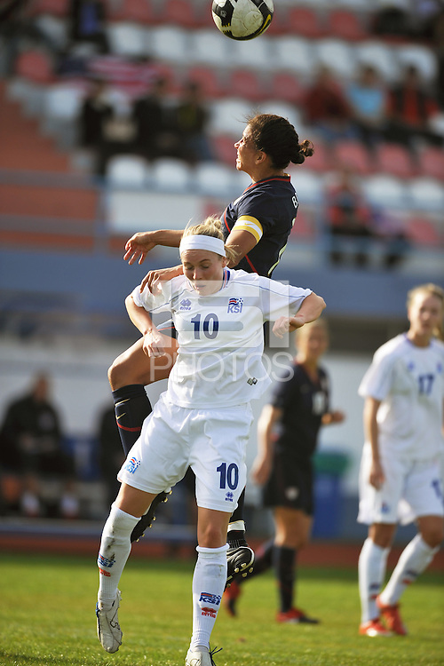 USA Captain, #7 Shannon Boxx, wins a header over Iceland's #10, Dora Maria Larufsdottier, in Vila Real Sto. Antonio at the Algarve Cup in Portugal.