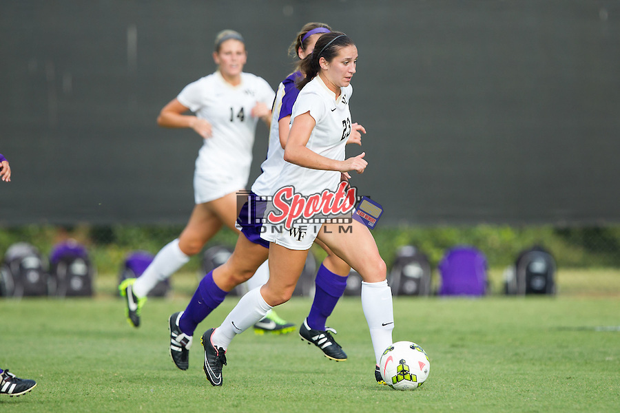 Kendall Fischlein (23) of the Wake Forest Demon Deacons pushes the ball up the field during first half action against the James Madison Dukes at Spry Soccer Stadium on August 29, 2014 in Winston-Salem, North Carolina.  The Dukes defeated the Demon Deacons 2-1.   (Brian Westerholt/Sports On Film)