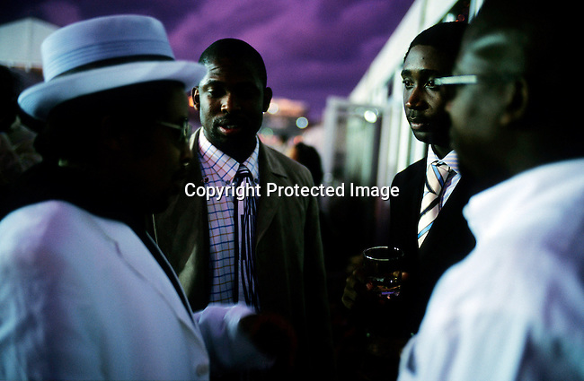black empowerment,middle-class,black,race,event,.Black yuppies socialize between races at the Durban July race on July 3, 2004 at Greyville race course in Durban, South Africa..©Per-Anders Pettersson/iAfrika Photos