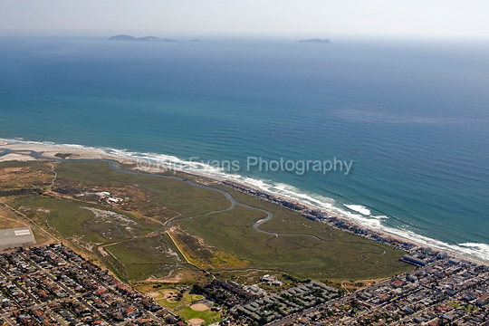 Aerial view of the Tijuana River National Estuarine Reserve looking southwest toward the Coronado Islands off the coast of Mexico.