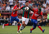 SANTIAGO DE CHILE - CHILE: 06-02-2019: Lucas Passerini de Club Deportivo Palestino (CHL) disputa el balón con Nicolás Palacios y Jesús Murillo de Deportivo Independiente Medellín (COL), durante partido de la Segunda fase, llave 4, entre Club Deportivo Palestino (CHL) y Deportivo Independiente Medellín (COL), por la Copa Conmebol Libertadores 2019 en el estadio San Carlos de Apoquindio, de la ciudad de Santiago de Chile. / Lucas Passerini of Club Deportivo Palestino (CHL), vies for the ball with Nicolas Palacios and Jesus Murillo of Deportivo Independiente Medellin (COL), during a match between Club Deportivo Palestino (CHL) and Deportivo Independiente Medellin of the second phase, key 4, for Copa Conmebol Libertadores 2019 at the San Carlos de Apoquindio Stadium, in the city of Santiago de Chile. Photos: VizzorImage / Javier Valdes Larrondo / Cont. / Xpress Media