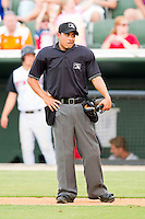 Home plate umpire Roberto Moreno between innings of the South Atlantic League game between the Hagerstown Suns \and the Kannapolis Intimidators at CMC-Northeast Stadium on June 9, 2012 in Kannapolis, North Carolina.  The Suns defeated the Intimidators 11-6.  (Brian Westerholt/Four Seam Images)