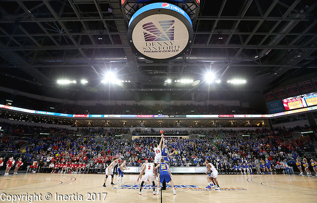 SIOUX FALLS, SD: MARCH 6: Tyler Flack #23 from the University of South Dakota jumps the opening tip with Mike Daum #24 from South Dakota State University during the Summit League Basketball Championship on March 6, 2017 at the Denny Sanford Premier Center in Sioux Falls, SD. (Photo by Dave Eggen/Inertia)