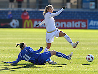 US defender Heather Mitts (2) avoids a sliding tackle by Italian forward Elisa Camporese (11).  The U.S. Women's National Team defeated Italy 1-0 at Toyota Park in Bridgeview, IL on November 27, 2010 to advance to the Women's World Cup in Germany.