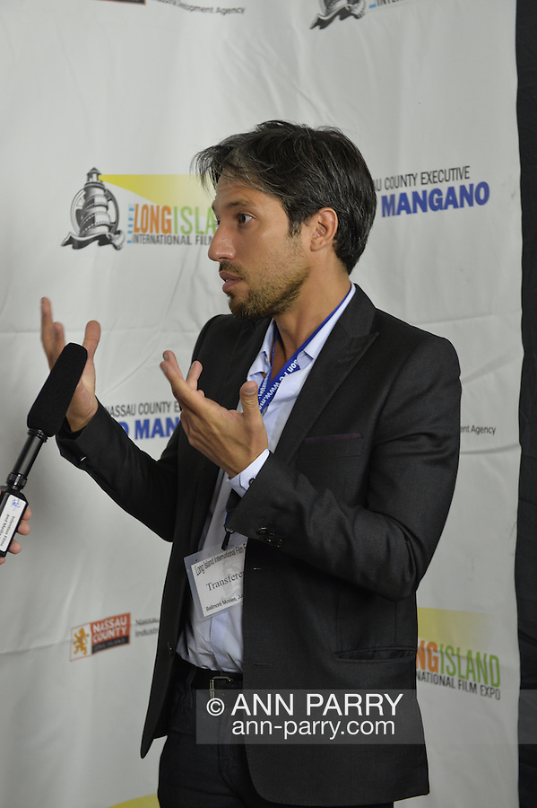 Bellmore, New York, United States. July 10, 2015. MICHAEL NAKACHE, the Director of the short film TRANSFERENCE, is interviewed at the Official Opening Night Reception and Technical Awards presentation of LIIFE, Long Island International Film Expo, in the Filmmakers Lounge. Transference is about a young psychoanalyst whose new patient is more than she bargained for. LIIFE events, including screenings nextdoor at Bellmore Movies, panels, and ceremonies, span from July 9 through July 16.