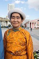 Mongolia, Ulaanbaatar. Woman in Sukhbaatar Square.