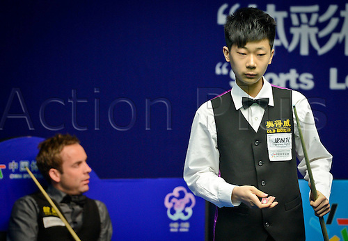 19 06 2013   Wuxi China. Lyu Haotian of China   Against Allister Carter of England during their Second Round of Snooker Wuxi Classic Match in Wuxi East Chinas Jiangsu Province