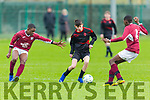 St Brendans Park's Cianan Cooney pushes forward as  Emmanuael Biodun and Lee Ward of Renmore of Galway close him down in the U15 National Cup in Christy Leahy Park on Saturday.
